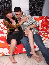 Stephanie charms a younger guy by showing off her flabby breasts and natural unshaved snatch