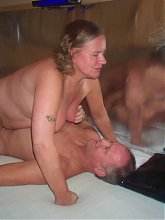 Kinky mature couple playing in front of the camera