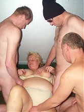 This chubby mature slut gets three cocks to work with