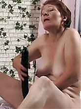 Naughty grandma Nathalie plays with a sex toy and later gets her pussy extremely screwed