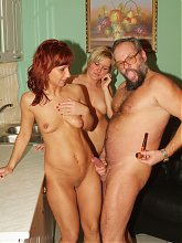 Pretty blonde Sylvia joins a sexy mature Myra Cave in the kitchen for a live threesome